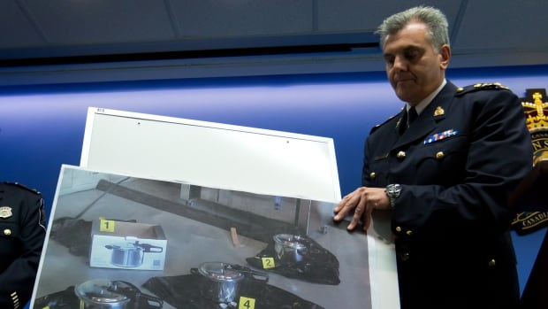 Wayne Rideout, the RCMP's assistant commissioner, shows the pressure cookers investigators said were intended as explosive devices in an Al-Qaeda-inspired plot to explode a bomb at the B.C. Legislature on Canada Day. The Harper government wants researchers to provide insight into the connection between violent extremism and the internet.