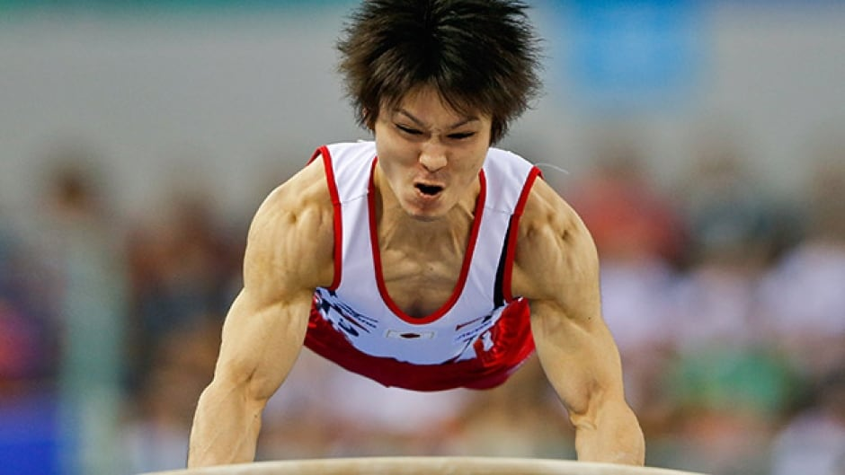 KOHEI UCHIMURA JAPANESE GYMNASTICS STAR 8X10 SPORTS ACTION PHOTO V