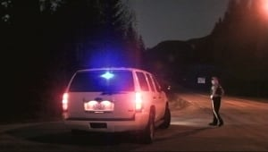 RCMP officer maintaining roadblock at Slocan, B.C.
