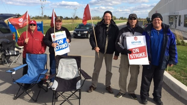 Workers picket outside the Navistar parts distribution centre in Hamilton on Friday.