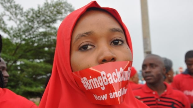 A woman attends a demonstration in Abuja, Nigeria, Thursday Sept. 11, 2014, calling on the government to rescue the kidnapped girls of the government secondary school in Chibok. More than 200 schoolgirls were kidnapped from a school in Chibok in Nigeria's north-eastern state of Borno on April 14. Boko Haram claimed responsibility for the act.