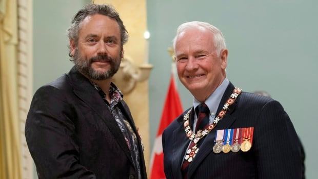 W. Brett Wilson, left, seen receiving the order of Canada in 2012 from Gov. Gen. David Johnston, was diagnosed with prostate cancer in 2001. The former Dragons' Den panellist said his cancer has returned but vowed to beat it.