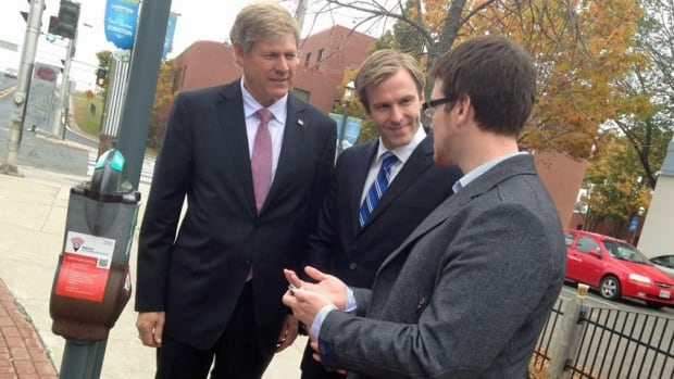 Phillip Curley, the chief executive officer of HotSpot Parking, talks to Premier Brian Gallant and Deputy Premier Stephen Horsman on Tuesday morning. The provincial government is investing $90,000 in the company to help it expand and hire six new employees.