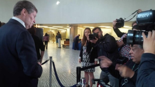 John Tory waits to vote in advance poll