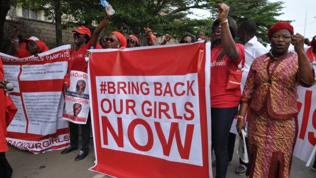"Demonstrators in Abuja, Nigeria, Oct. 14 call on the Nigerian government to rescue the schoolgirls kidnapped from Chibok.  Scores of protesters marched, chanting ""Bring Back Our Girls."" The girls were kidnapped six months ago by Boko Haram."