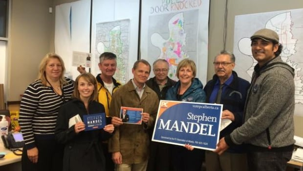 Speaker Gene Zwozdesky, second from the right, was photographed volunteering on the campaign for Progressive Conservative candidate Stephen Mandel on Wednesday night.