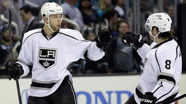 Kings defenceman Jake Muzzin, left, has signed a five-year contract extension worth $20 million US. The native of Woodstock, Ont. has evolved into a solid NHL blue-liner over the past two seasons, and frequently plays alongside Drew Doughty in the Kings' top defensive pairing.