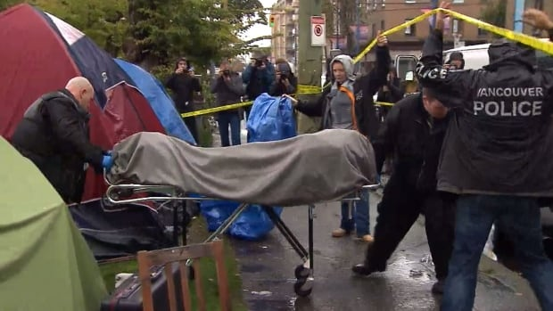 Vancouver police and the BC Coroner's Service remove the body of a 69-year-old man from a tent in Oppenheimer Park Wednesday afternoon.