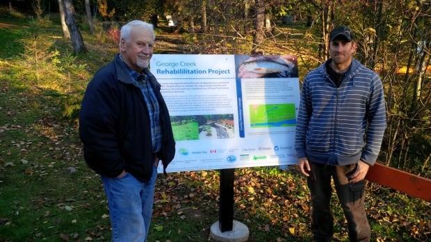 Frank Edgson (left) of the North Shore Steelhead Association and Glen Garach with TBT Engineering, at George Creek in Centennial Park.