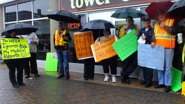 The rain didn't stop injured worker advocates from demonstrating outside Sudbury's Workplace Safety and Insurance Board Thursday. They were raising awareness about four benefit updates that are taking effect Nov. 1.