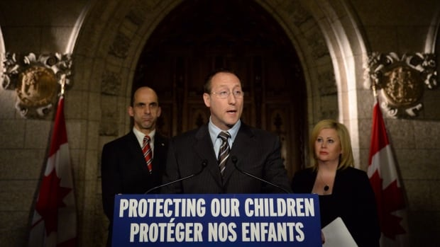 Justice Minister Peter MacKay speaks about cyberbullying as Public Safety Minister Steven Blaney, left, and Lianna McDonald of the Canadian Centre for Child Protection join him during Bullying Awareness Week last November. MacKay's cyberbullying bill, C-13, is moving through the Commons, but faces some opposition over privacy concerns.