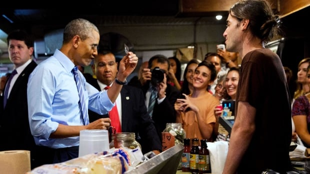 U.S. President Barack Obama scrutinizes his credit card at a restaurant in Austin, Texas. His under-used credit card was declined last month at a New York restaurant.