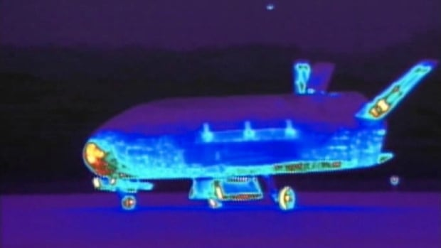 A 2012 file photo shows an infrared view of the X-37B unmanned spacecraft landing at Vandenberg Air Force Base. The orbiter blasted off on its latest mission today.