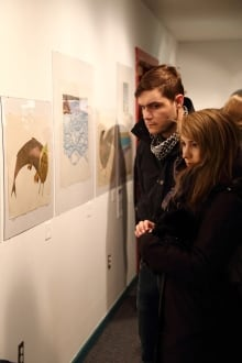 People look at Cape Dorset print