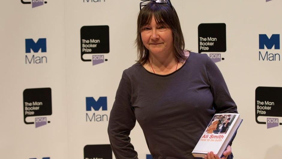 Man Booker prize 2014 nominee British author Ali Smith holds her book 'How to be Both' in London, Monday, Oct. 13, 2014.