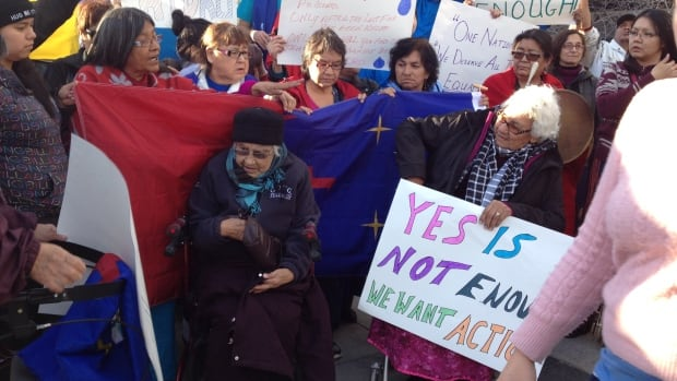 Members of the Pimicikamak Cree Nation protest outside Manitoba Hydro's headquarters building in downtown Winnipeg on Oct. 23 to raise concerns about the Jenpeg hydroelectric power-generating station.