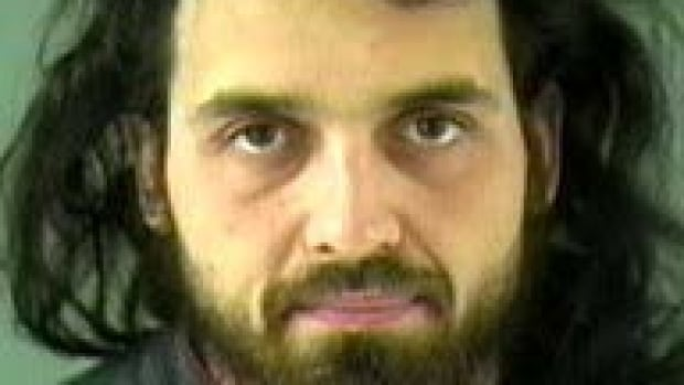 NDP Leader Tom Mulcair has suggested that Michael Zehaf-Bibeau, 32, had committed a 'criminal act' and that, based on the shooter's past, there wasn't enough evidence to describe his actions as terrorism.