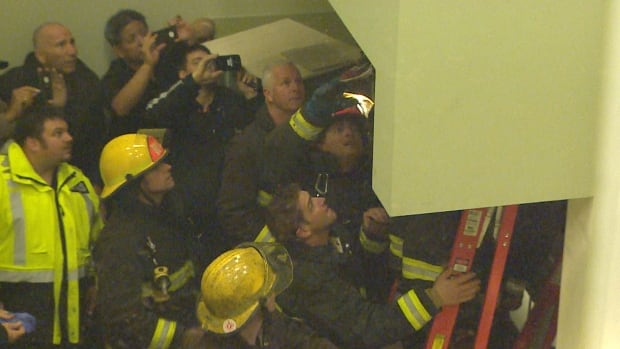 Fire rescue officials cut open a vent and safely extract a young man trying to sneak into the 11th annual Dooms Night concert at the PNE.