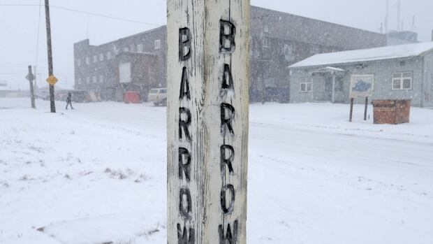 In this Oct. 10, 2014 photo, snow falls on a corner of Barrow, Alaska, which is now called Utqiagvik. A late September storm in the community lasted several days. It eroded roads and damaged infrastructure and personal property.