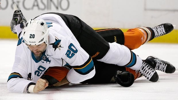 Sharks enforcer John Scott, top, fights with the Ducks' Tim Jackman during the first period on Sunday in Anaheim, Calif. Scott and Jackman's fight started a line brawl. They were assessed 22 and 21 penalty minutes, respectively in the game. San Jose and Anaheim combined for 165 penalty minutes.