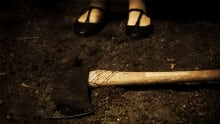 Axe with girl's feet