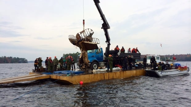 Two young airmen killed during the Second World War were honoured with a moment of silence Tuesday as wreckage of their crashed plane was pulled from an Ontario lake. A recovery team hoisted a wheel and part of the plane's tail section from Lake Muskoka, where the Northrop A-17 Nomad aircraft sank in Dec. 1940 after a mid-air collision.
