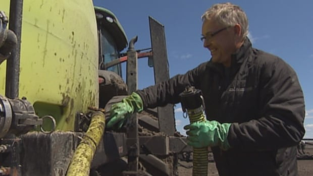 Lac Du Bonnet farmer Cameron Neurenberg questions why a provincial government flood compensation program was used to pay for a contractor's faulty work.
