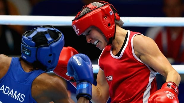 Canadian Pan Am Games hopeful Mandy Bujold, right, won a bronze medal at this year's Commonwealth Games in Glasgow, where women's boxing was on the program for the first time.
