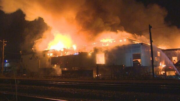 A three-alarm blaze engulfed the MacKenzie Sawmill in Surrey early Saturday morning.