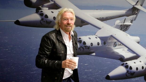 Richard Branson, shown at the Virgin Galactic hangar at Mojave Air and Space Port in Mojave, Calif., will be a passenger on one of the first commercial flights of the new SpaceShipTwo.