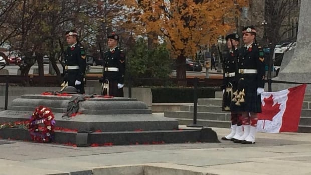 Cpl. Branden Stevenson (right) stands guard at the Tomb of the Unknown Soldier in Ottawa on Monday, less than two weeks after his friend Nathan Cirillo was fatally shot at the same location.