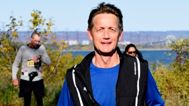 Richard Greidanus, photographed here midway through the Road2Hope half-marathon, collapsed just before the running race's finish line and later died. Friends remembered him as an avid runner, but also a kind and caring family man.