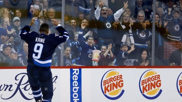 Winnipeg Jets' Evander Kane gets the crowd going as he makes his way to the penalty box after his fight with Pittsburgh Penguins' Simon Despres during Thursday's game.