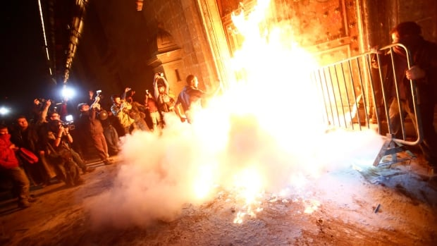 A group of protesters set fire to the wooden door of Mexican President Enrique Pena Nieto's ceremonial palace in Mexico City, demanding justice for students who were abducted six weeks ago and apparently murdered and incinerated by corrupt police.