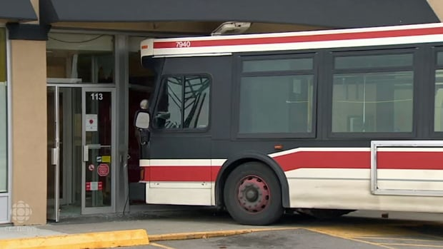 This TTC bus rolled about 150 metres from the impact site before crashing through the doors of this CIBC bank.