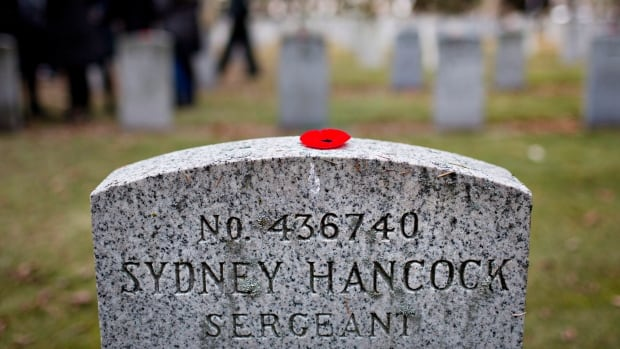 A poppy lies on the grave of Sergeant Sydney Hancock during the commemoration event 'No Stone Left Alone' at Beechmount Cemetery in Edmonton on Nov. 6, 2014.