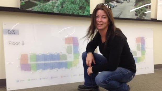Robbin Foxcroft looks at the plans for the condo development where she bought a unit with help from Attainable Homes Calgary Corporation.