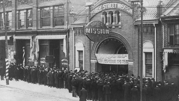 Food line at Yonge Street Mission in Toronto during the Great Depression.