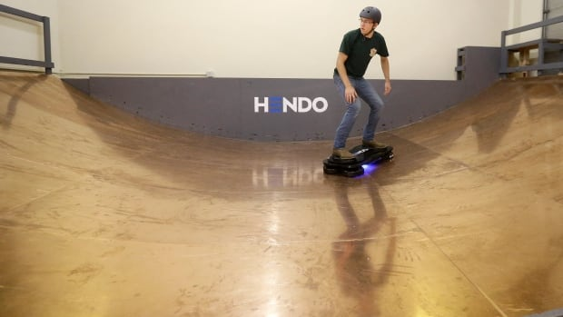 Arx Pax engineer Garrett Foshay demonstrates riding a Hendo Hoverboard in Los Gatos, Calif.