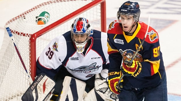 Connor McDavid, right, is now in doubt for the upcoming world junior championship in Toronto and Montreal.