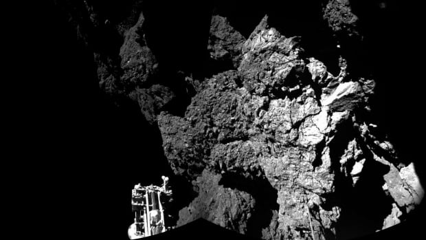 A combination of different images taken by Philae cameras shows the space probe safely on the surface of comet 67P/Churyumov-Gerasimenko. One of the lander's three feet can be seen in the foreground.