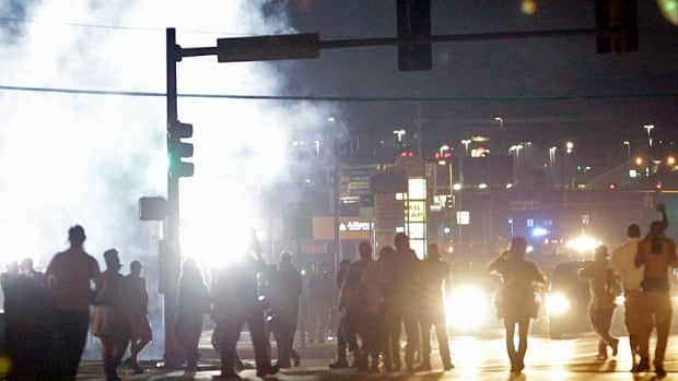 Weeks after the Aug. 9 shooting of Michael Brown, crowds kept protesting amidst the clouds of tear gas in Ferguson, Mo.