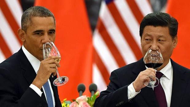 U.S. President Barack Obama and Chinese President Xi Jinping drink a toast in the Great Hall of the People on Nov. 12, 2014, shortly after agreeing to an ambitious plan to limit greenhouse gases.