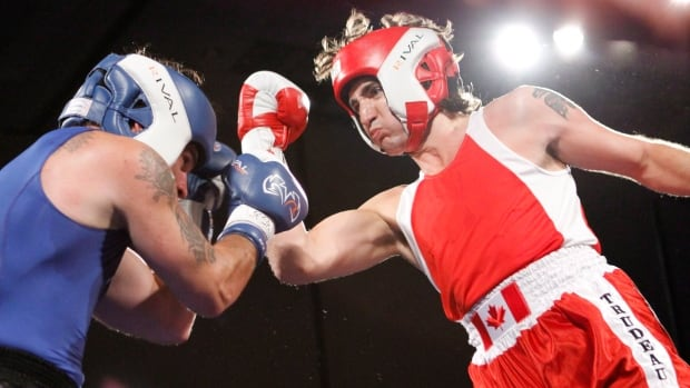 Then-Conservative Senator Patrick Brazeau (left) and Liberal MP Justin Trudeau are seen here fighting in a charity boxing match for cancer research Saturday, March 31, 2012 in Ottawa. Trudeau won in the third round. A year later, he was named Liberal leader. Brazeau was later suspended from the Senate for ineligible expenses.
