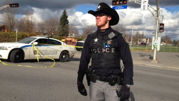 A Châteauguay police officer wears the new sheriff uniform while investigating a suspicious package.