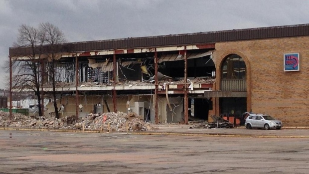 The Bay building at Highfield Square yields to demolition crews on Tuesday.