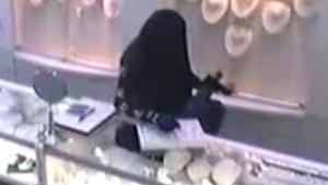Still image from police video of bank robbery suspect