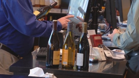 Wine bottles at checkout counter - Nov. 19, 2014