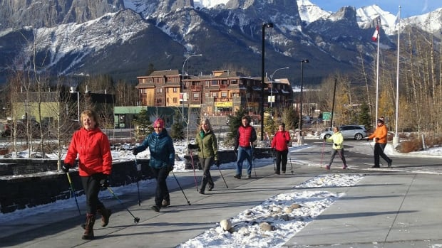Urban pole walkers take a stroll through Canmore on Wednesday.