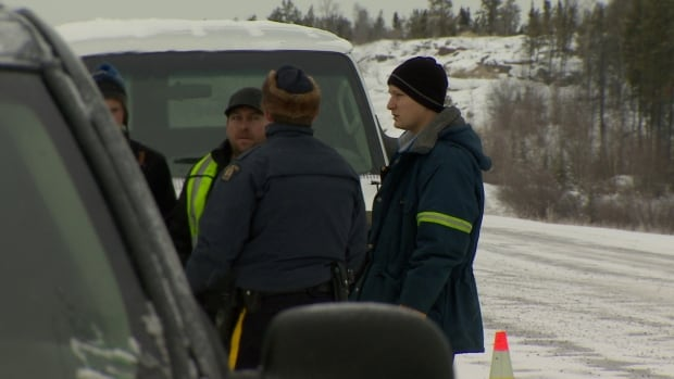 RCMP and rescue officials gather at a muster point on the N.W.T.'s Highway 3 about 40 minutes north of Yellowknife. The pilot and five passengers on board an Air Tindi Cessna Caravan waited about 4 hours before they were reached by helicopter.